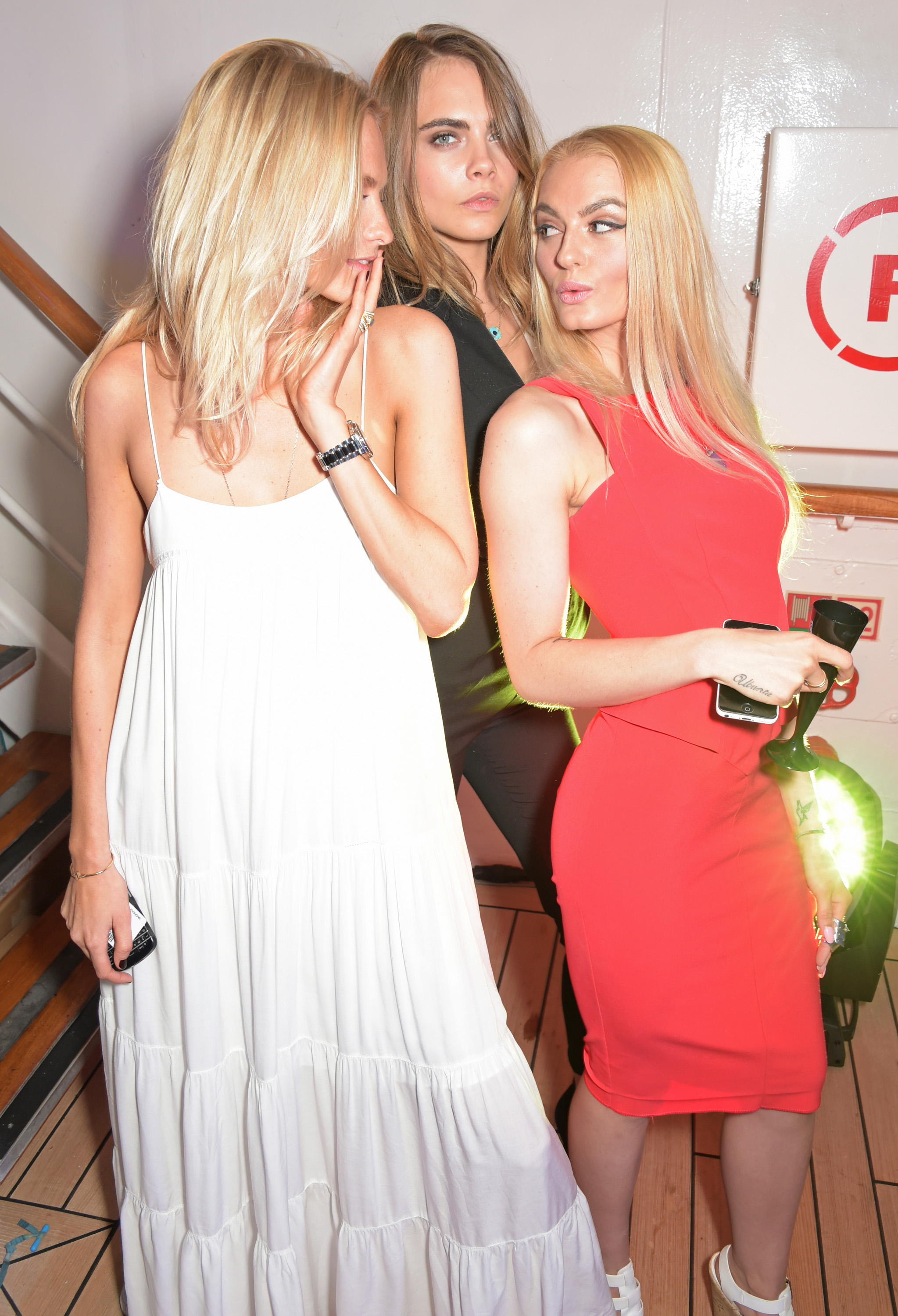 MONACO - MAY 23:  (L to R) Poppy Delevingne, Cara Delevingne and guest attend the TAG Heuer Monaco Party on May 23, 2015 in Monaco, Monaco.  (Photo by David M. Benett/Getty Images for TAG Heuer) *** Local Caption *** Poppy Delevingne; Cara Delevingne