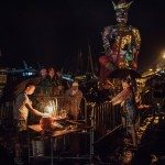 """HONG KONG - MAY 25:  People make offerings to the """"Demon God"""" during the Bun Festival on May 25, 2015 on Cheung Chau Island in Hong Kong. One of Hong Kong's most colourful cultural celebration events, Cheung Chau Bun Festival, will be staged on 25 May 2015 (Monday) until 26th May 2015 midnight (Tuesday). The festival has over 100 years of history. Every year, thousands of people descend upon the tiny island for The Piu Sik (Floating Colours) Parade, Lucky Bun (Ping On Bun) and The Bun Scrambling Competition, the ancient custom during the festival. The tradition has been passed down for generations. To ensure the tradition keeps passing on, every year, Cheung Chau Islanders fuse the new elements with the custom to draw the attention from the young. This year, 'K-Pop stars' will be featured by one of the Piu Sik parade teams, the first-ever 'Ping On (Lucky) Macaron' with Chinese tea favour is invented, and more to be found out on the island.  (Photo by Anthony Kwan/Getty Images for Hong Kong Images)"""